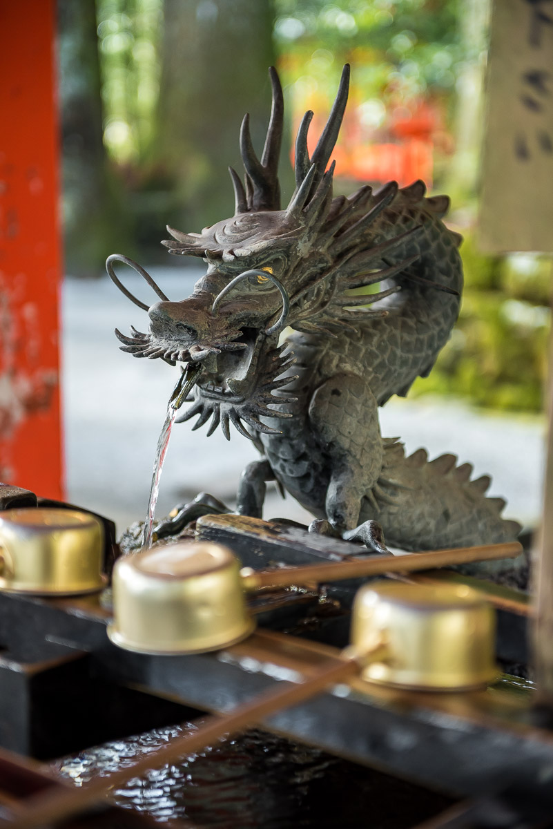 Detail of a water fountain shaped like a dragon in a temple in Japan