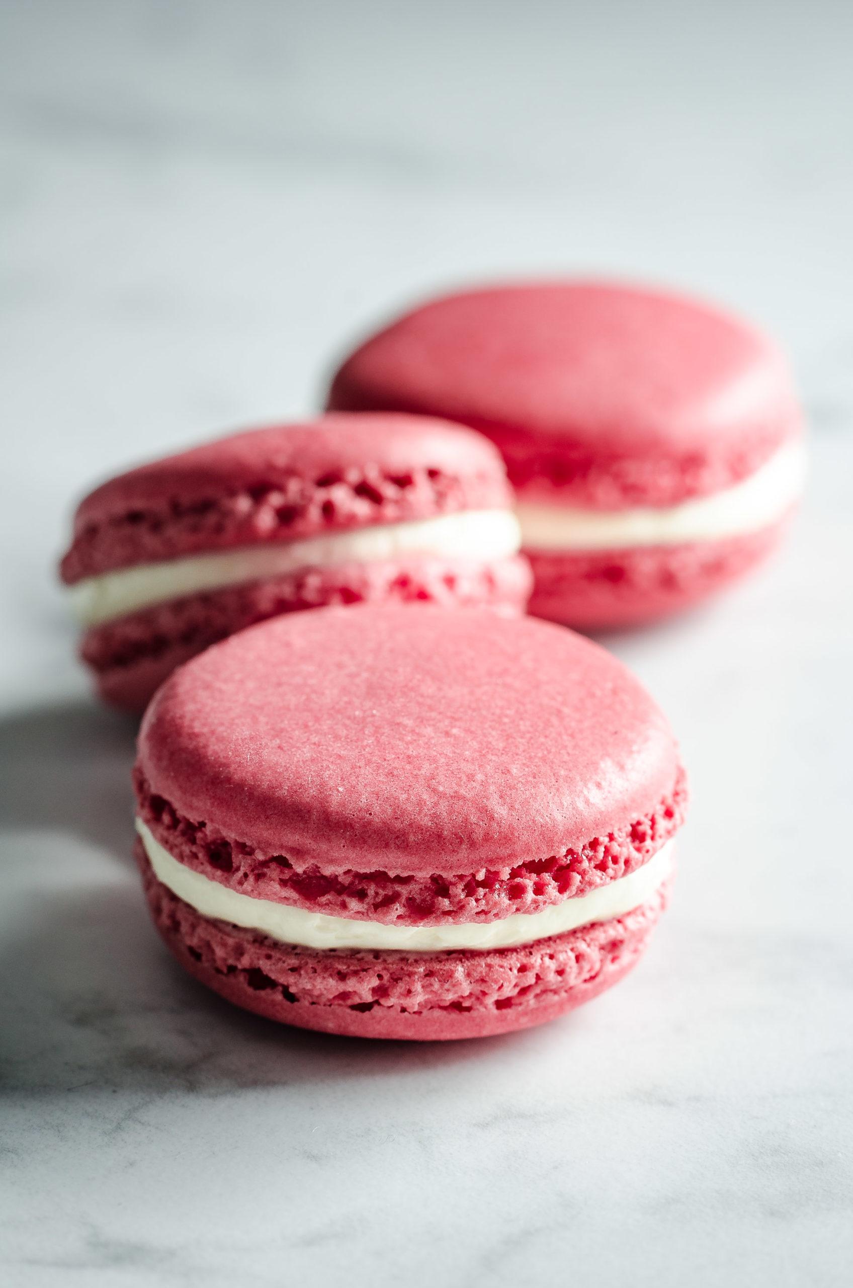Pink macarons on white