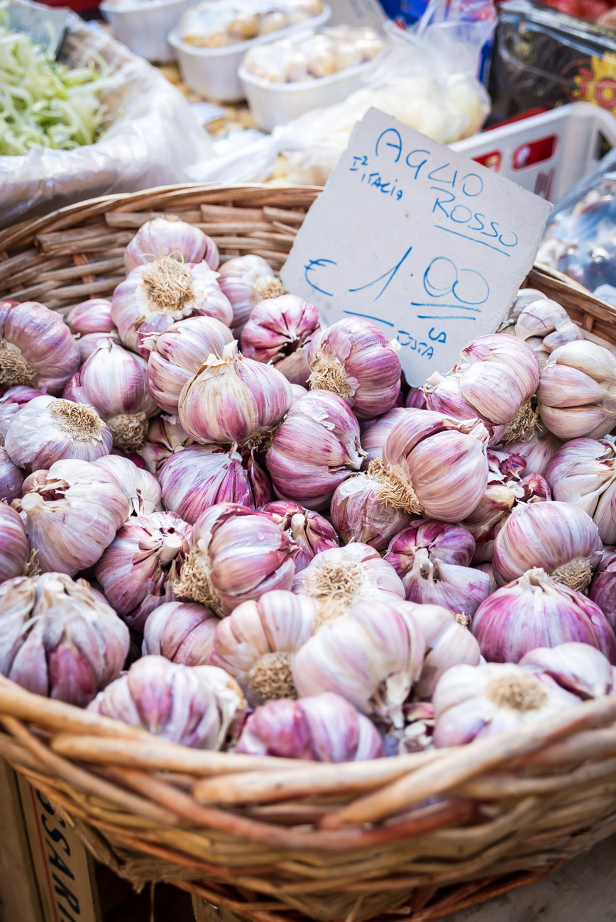 Basket with beautiful purple garlic in a market in Rome