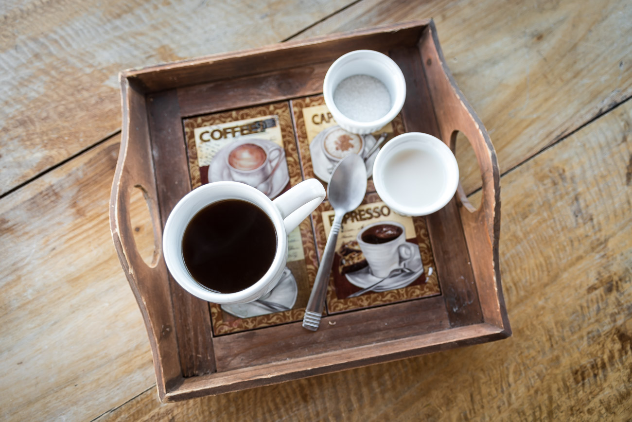 Breakfast tray with black coffee