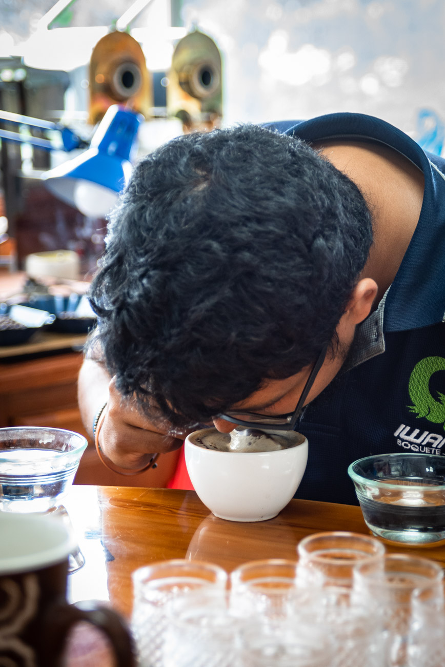 man smelling the aroma of coffee before tasting