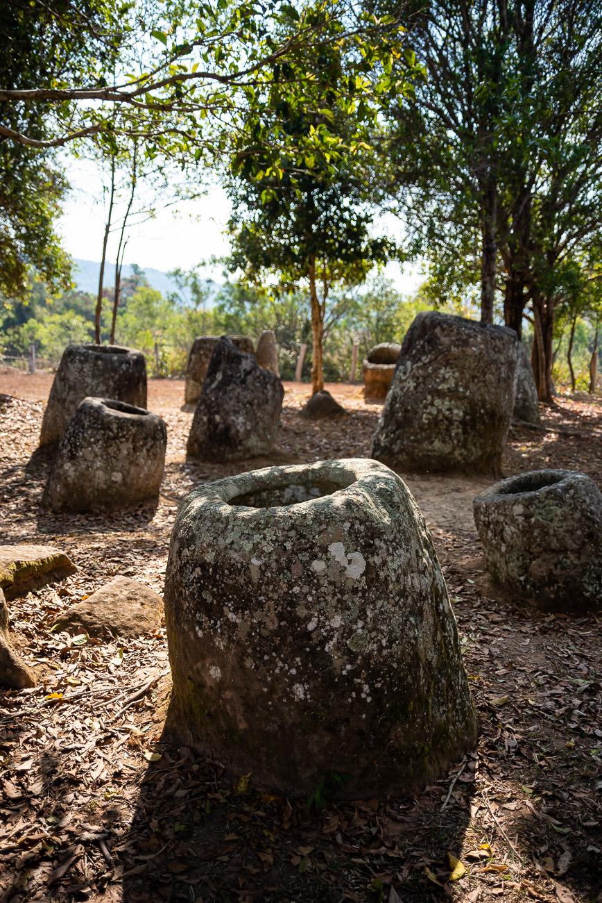 Huge prehistoric stone jar in the plain of jars in Laos
