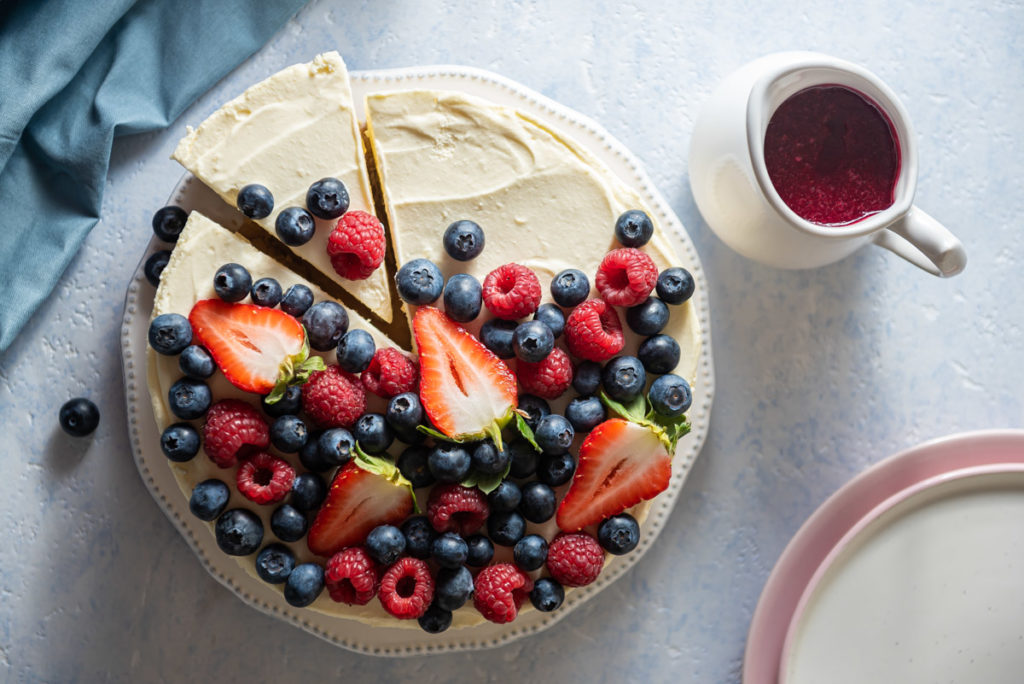 Cheesecake with assorted berries and berry sauce