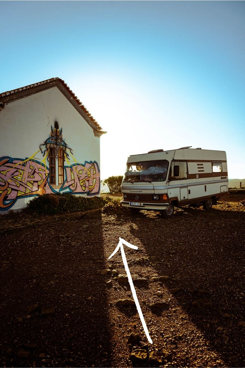 Example of leading lines in travel photography, camper van and house at sunrise