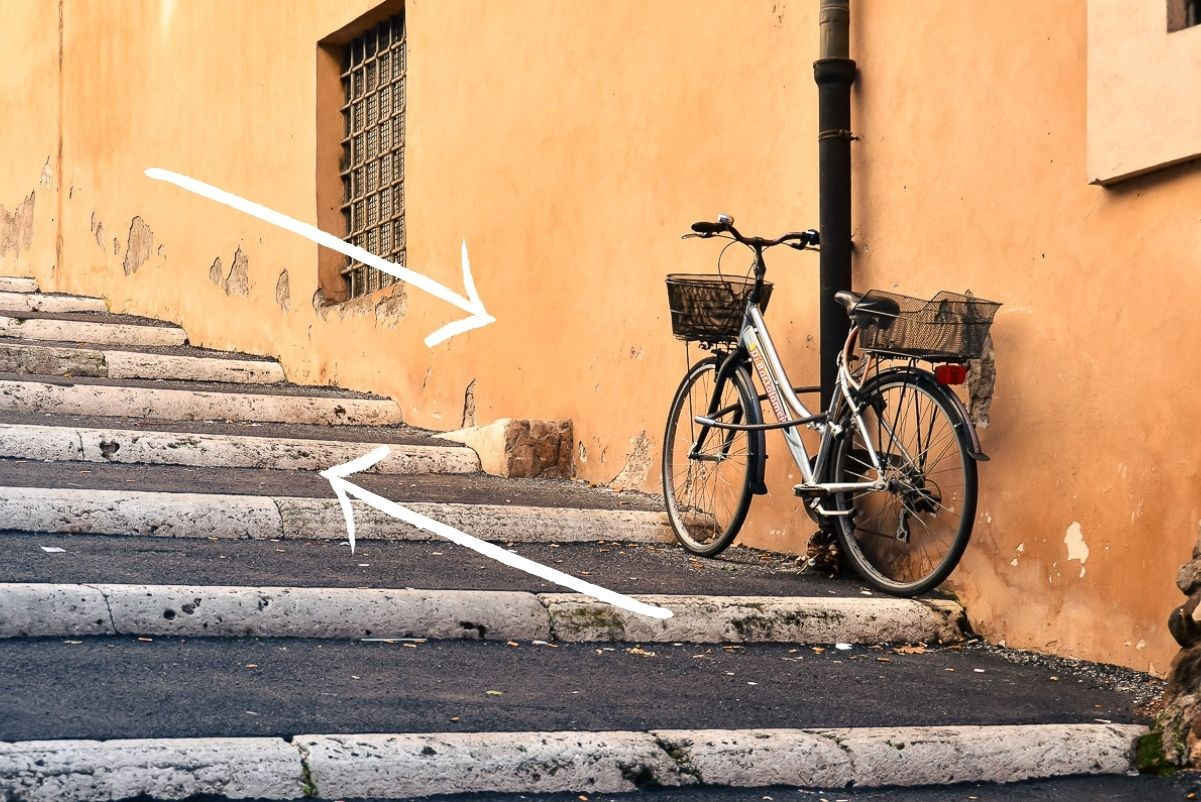 Example of leading lines in travel photography, bike on a street in Italy